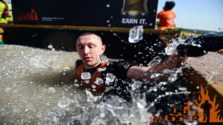 A man wades through a Tough Mudder ice bath